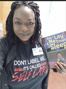 Woman wearing don't label me shirt to reduce the stigma of mental health